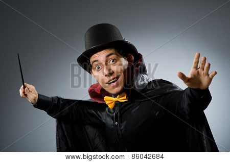 Funny magician man with wand and hat