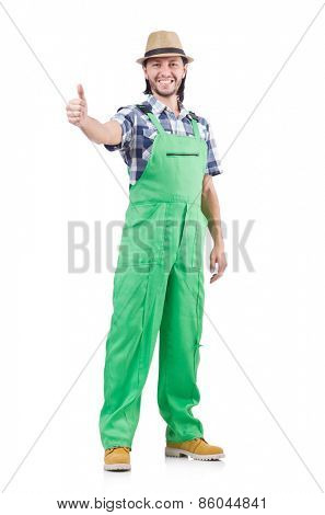 Young cheerful gardener in hat and green uniform isolated on white