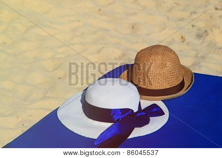 two hats on summer beach