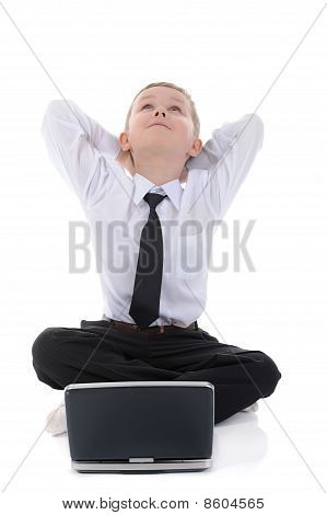Boy With A Laptop Sitting On The Floor.