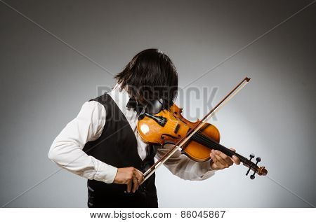 Musician plays cello isolated on white