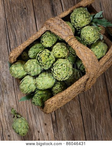 Raw Artichokes In A Aged Basket, Top View
