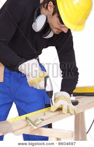Worker Screwing With Power Tools
