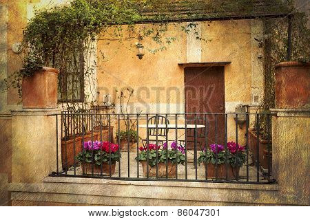 Small terrace decorated with flowers in Rome, Italy