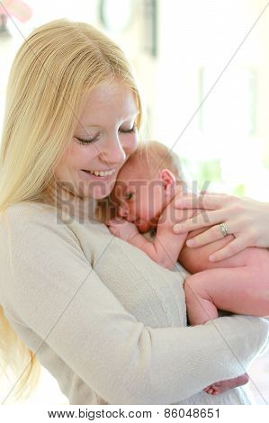 Happy Young Mother Holding Newborn Baby
