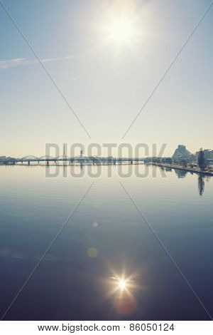 Beautiful scenery of Riga bridge and sun reflection in Daugava