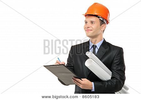 Young Construction Worker With Helmet Writng Down Notes