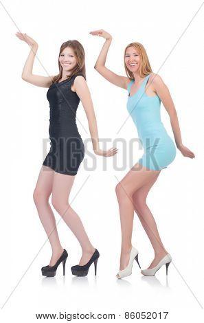 Female models in mini dresses isolated on white