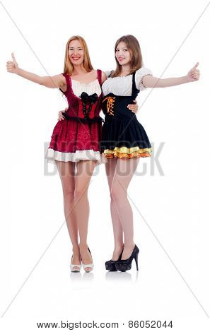 Girls in bavarian costumes isolated on white