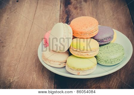 Colorful Macarons On A Wooden Floor