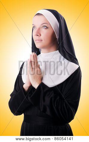 Young nun in religious concept