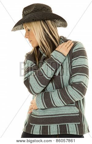 Cowgirl In Blue And Black Poncho Side Arms Folded