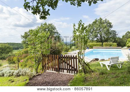 Landscaped Pool With Wooden Fence And Distant Views