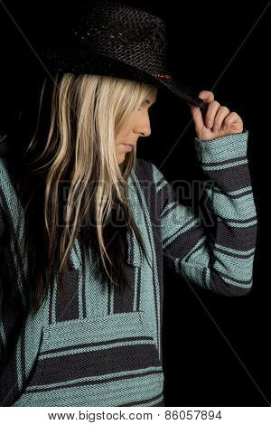 Cowgirl In Blue And Black Poncho Touch Hat Look Down
