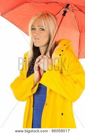 Woman In Yellow Rain Coat Under Red Umbrella Sad