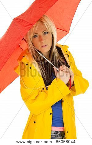 Woman In Yellow Rain Coat Under Red Umbrella Serious
