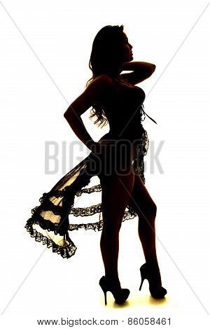 Silhouette Of Woman In Black Lingerie Standing One Hand On Hip