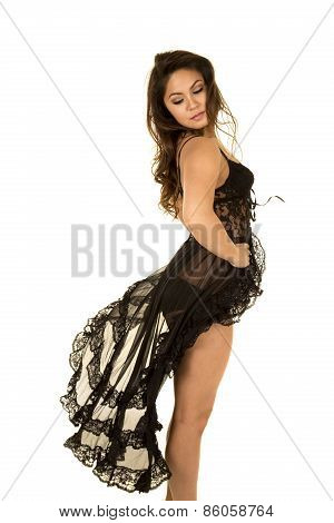 Woman Standing In A Black Night Gown Legs Showing Side