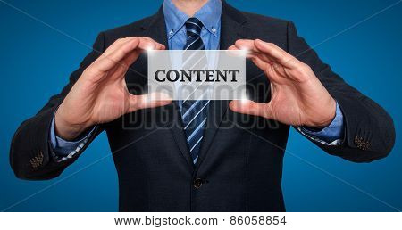 Businessman holds white card with Content sign, - Stock Photo
