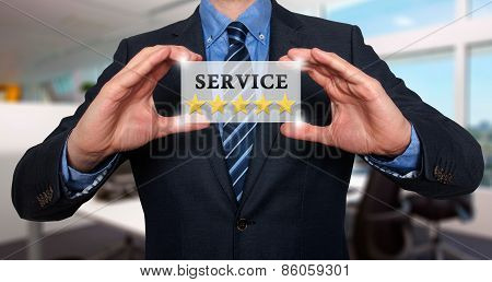 Businessman holding white card with Service Five Stars sign.