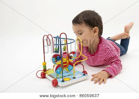 Little Girl Happy With Colorful Wooden Toy Isolated On White Background