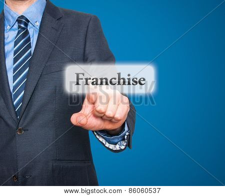 Business concept businessman pointing Franchise. Isolated on blue background.