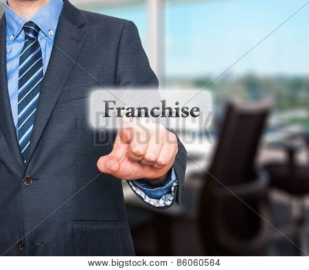 Business concept businessman pointing Franchise. Isolated on office background.