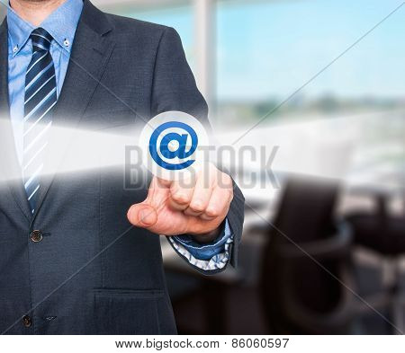 Businessman pressing mail button on visual screen. Customer support concept.