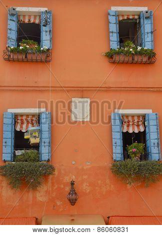 Blue Shutters On Orange Wall