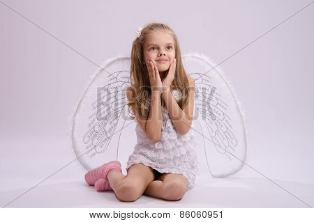 Seated Girl With Angel Wings