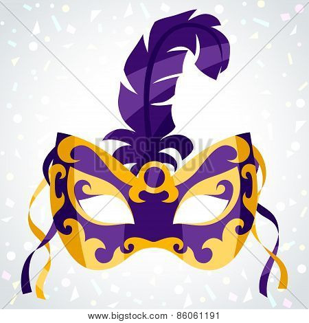 Festive carnival mask on background of confetti