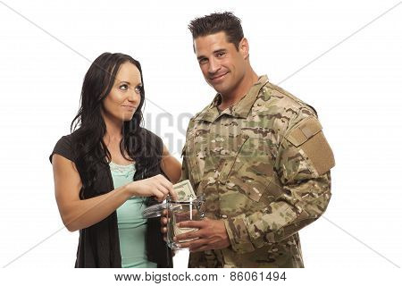 Couple Collecting Money In Jar