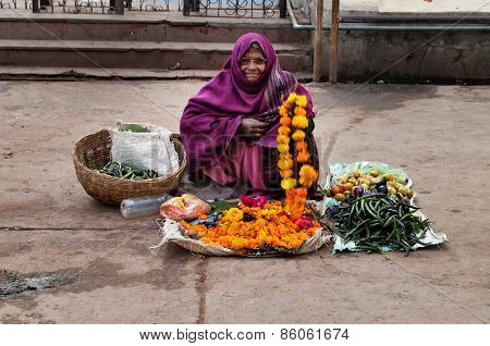 Old Poor Woman Sells Garlands Of Flowers At The Temple