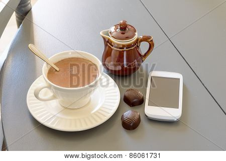 Cup Of Hot Chocolate With A Phone