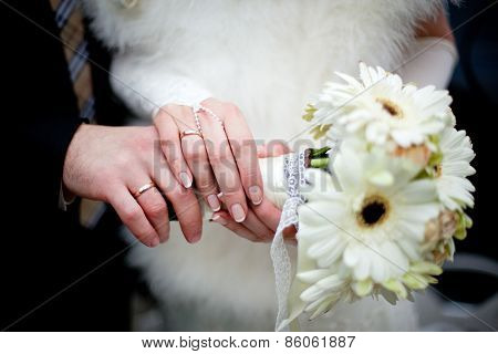Pastel wedding bouquet with roses in hands