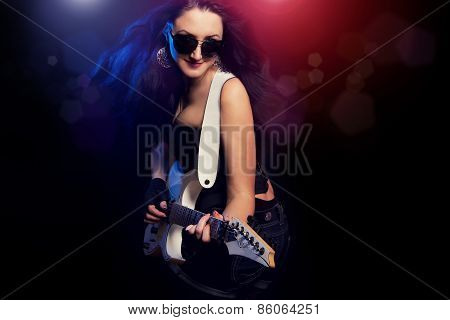 Fashion Girl With Guitar Playing Hard Rock