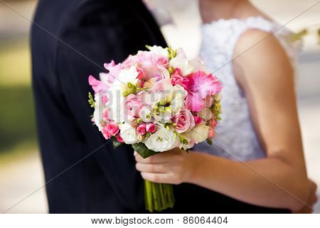 Pink wedding bouquet with roses and gladiolus