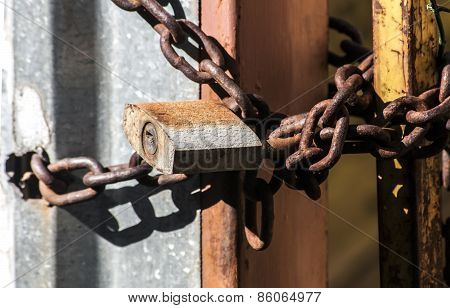Rusty padlock and metal chain