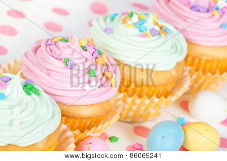 Pastel Easter Cupcakes With Candy And Sprinkles