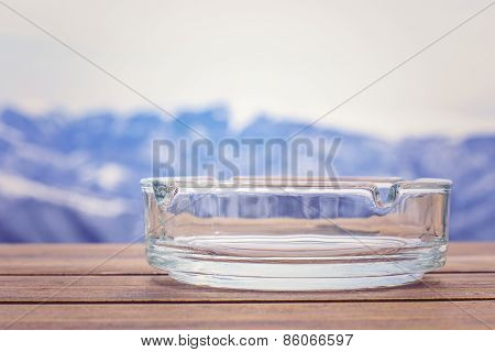Empty Glass Ashtray On A Wooden Table.