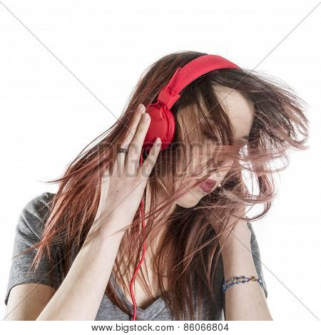 Young Woman Enjoying the Music from Headphone