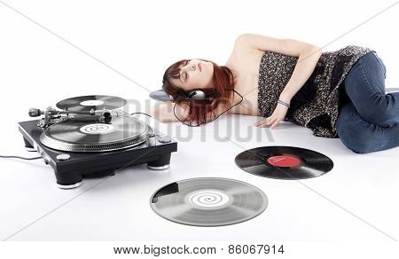 Young Woman Lying on the Floor Listening Music