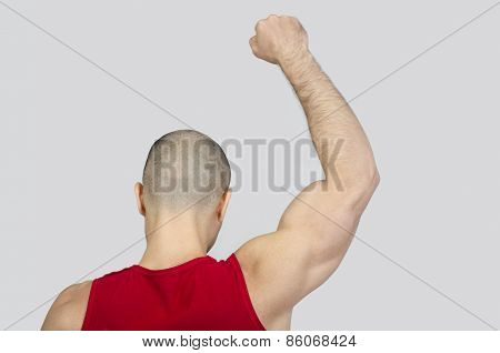 Man From The Back Raising His Arm And Fist.