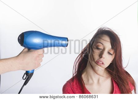 Sensual Young Woman Blow Dry her Long Hair