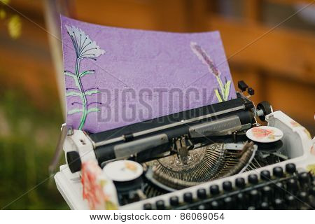 Vintage Typewriter With Fancy Paper
