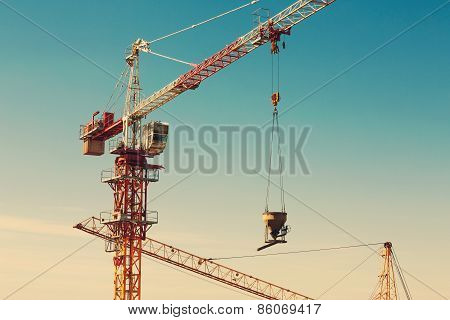 Tower Crane Lifting Up A Cement Bucket At Construction Area