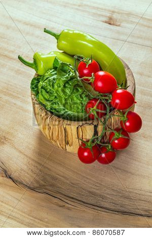 Bunch Of Vegetables In The Wooden Bowl