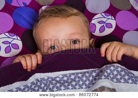 Little Boy Lay On The Bed