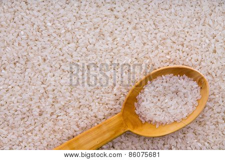 Parboiled Rice Grains With A Wooden Spoon