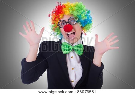 Woman clown businesswoman isolated on white
